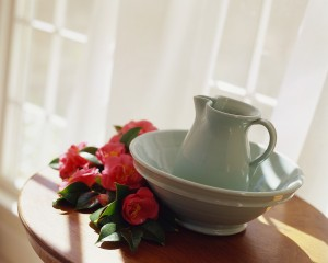 Pitcher in Bowl on Table