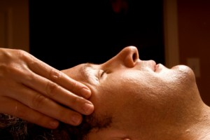 man getting a massage facial from therapist